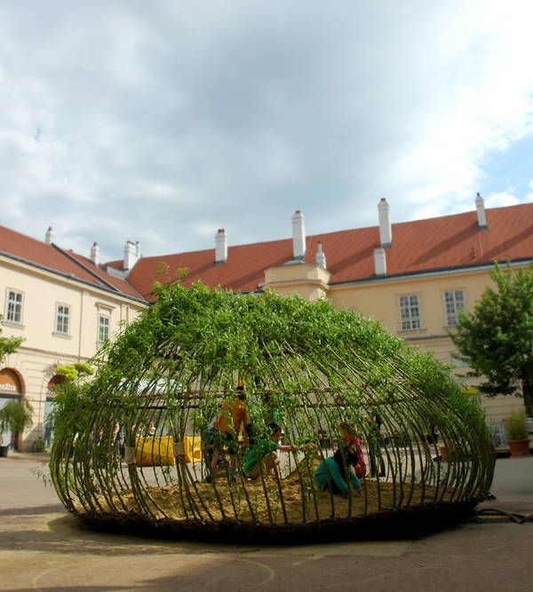 Kagome Sandpit in Vienna, via detail-online:  Living willow branches are rooted in a bag of humus underneath the sand and then horizontally interwoven with willow sticks to form an onion-shaped playhouse that can 'grow' atop asphalt. ('Kagome' is a reference to both a Japanese children's song, and a weaving pattern in Japanese basketry.) http://www.play-scapes.com/play-design/natural-playgrounds/kagome-sandpit-ppag-architects-vienna-austria-2012/ #Kids #Playspace #Green #Kagome