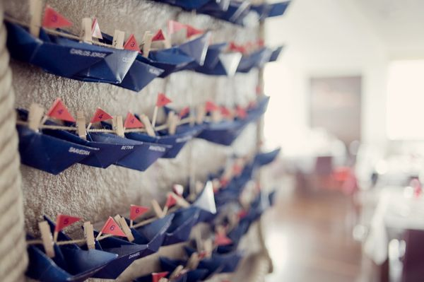 Paper boat seating idea for a nautical wedding