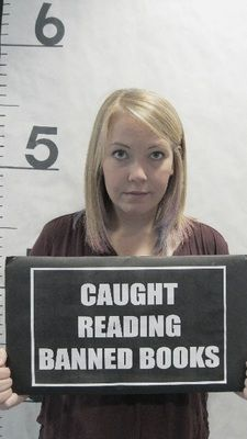 Another great banned book idea - this one's an interactive display from Oconee Library, where customers can get a picture holding the sign and standing like it's a mug shot!