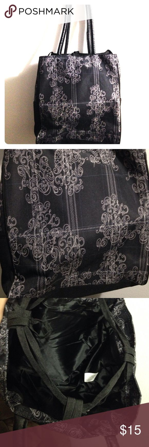 Black Victorian design tote bag Elegant design, near mint condition, has a zipper inside & a pouch on each side for water bottles. Very spacious inside & faux leather handles, love the bag but not the price? Make an offer ❤️ Bags Travel Bags