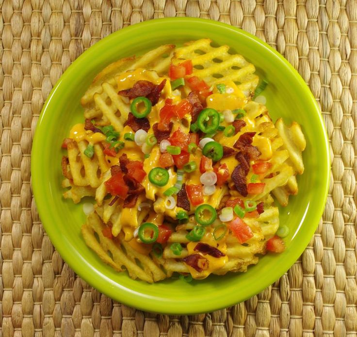 GAME DAY PREP: Here's what's on our menu for this Sunday – Potato Nachos! Waffle-cut fries replace traditional chips, but all the topping are still there – cheese sauce, jalapenos, tomatoes, scallions, and bacon crumbles. (We thought about adding cilantro, black olives, and avocado – but that would be too much. Or would it?).  Get Inspired with our great recipes, tips and more on #Facebook.