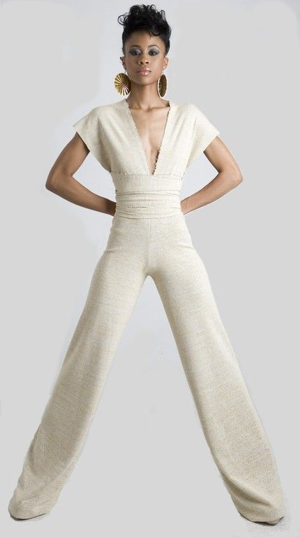 Love this Jumpsuit! Paired with white heels...those legs would look a mile long!!