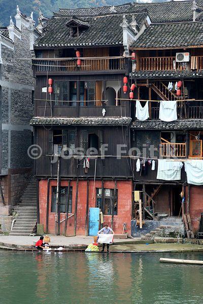 Wooden houses at the Tuo Jiang River, Fenghuang Town, Hunan, China