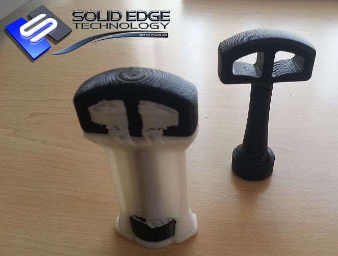 3D Printed Spanner. Printed in Black ABS Plastic. Spanner on the left still has support material surrounding it.