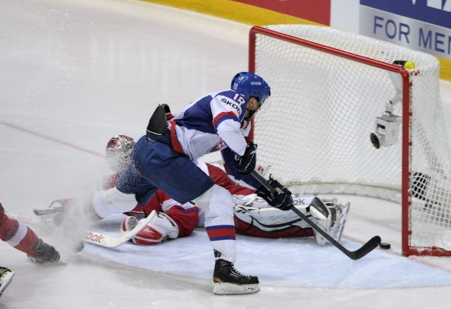 Slovakia's Miroslav Satan scores his second goal past Czech Republic's goalkeeper Jakub Kovar during the semi-final match Czech Republic vs Slovakia of the 2012 IIHF Ice Hockey World Championships in Helsinki, Finland, on May 19, 2012.