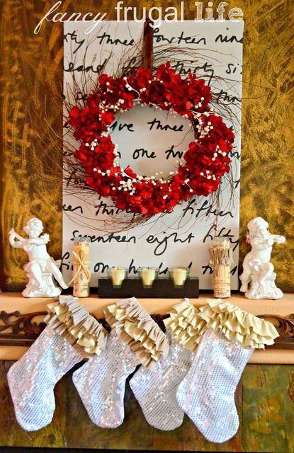 Here's a gorgeous Christmas mantle complete with holiday wreath! See more party ideas at CatchMyParty.com! #christmas #decorations #wreath #holidays