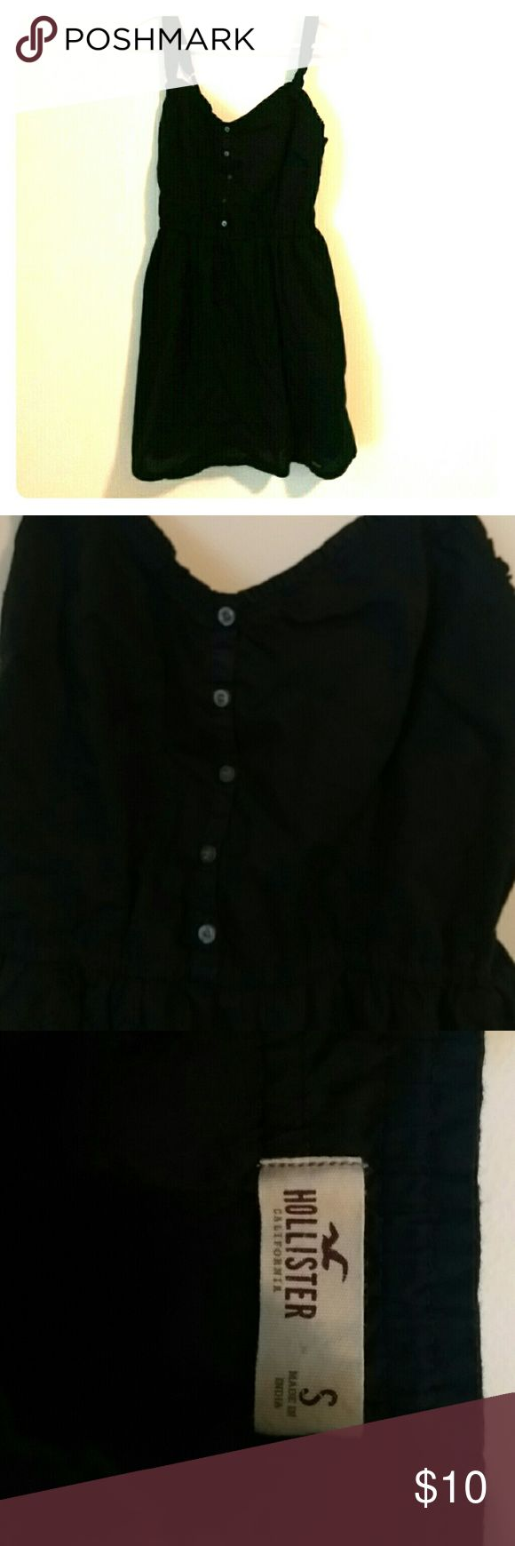 Dark Navy blue Hollister dress Dark Navy blue Hollister dress with about 1 inch straps and buttons down the front with a small flower print detail that the picture couldn't show. Worn once in awesome condition size small Hollister Dresses