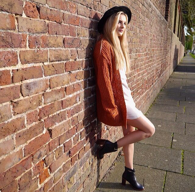 orange coat • black heeled boots • white cute dress • black brim hat • hipster •