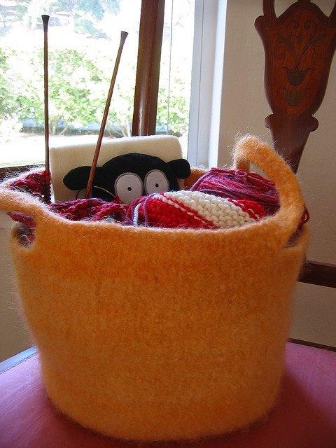 Would love to knit/felt some of these baskets-- we need a place to put all the matchbox cars!