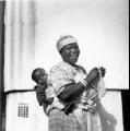I think it's a dishcloth! Woman with Infant    PHOTOGRAPHER:  Larrabee, Constance Stuart 1914-2000  PHYSICAL DESCRIPTION:  negative : b&w ; 6 x 6 cm. (silver gelatin)  TYPE:  Photographic prints  DATE:  1949  DATA SOURCE:  Eliot Elisofon Photographic Archives