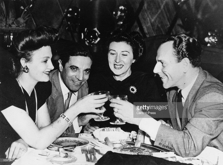 From the left, unidentified female with shipping magnate Aristotle Onassis (1906 - 1975) and friends Katina Paxinou and Alex Minotis.