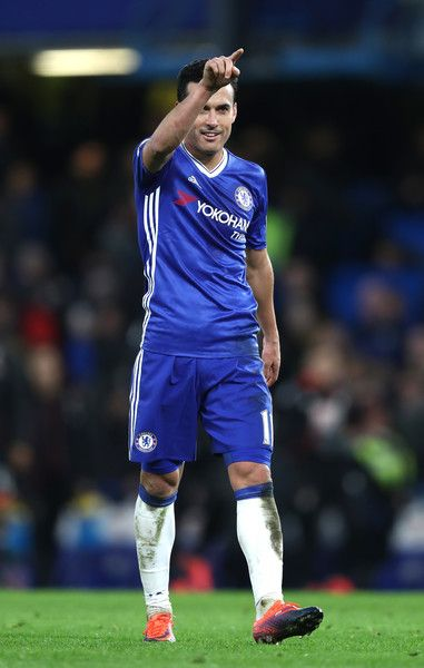 Pedro of Chelsea celebrates after scoring his second and his sides third during the Premier League match between Chelsea and AFC Bournemouth at Stamford Bridge on December 26, 2016 in London, England.