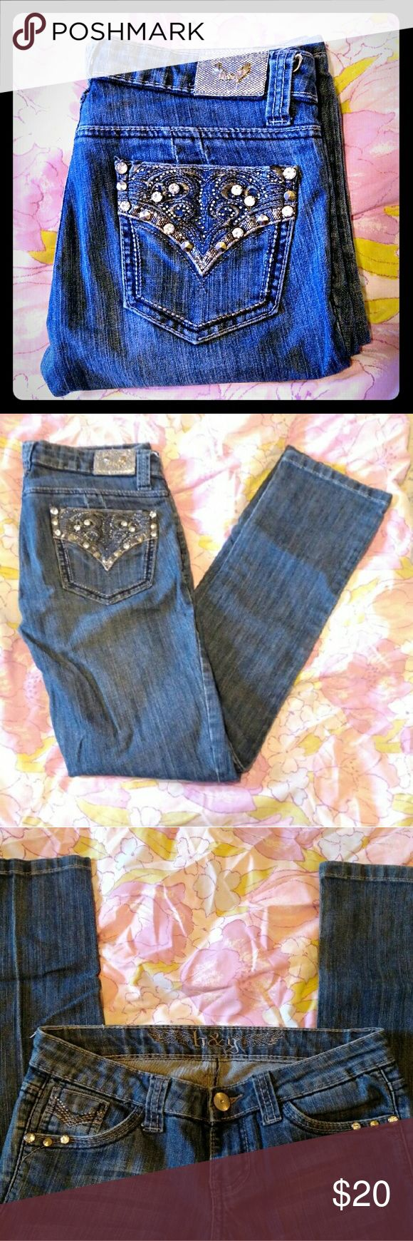 H & G Studded Pocket Skinny Jeans Adorable, edgy studded skinny jeans! Perfect for any rock look! Embroidery, Silver rhinestones and studs on the back pockets. Lots of bling! Stretch denim, dark wash. I didn't see any studs missing or damage when I looked over these again.  H & G Size: Junior's 7  *If you notice anything wrong with an item that I might have missed, please let me know. I want you to love your item. Thank you & happy poshing!* H & G Jeans Skinny