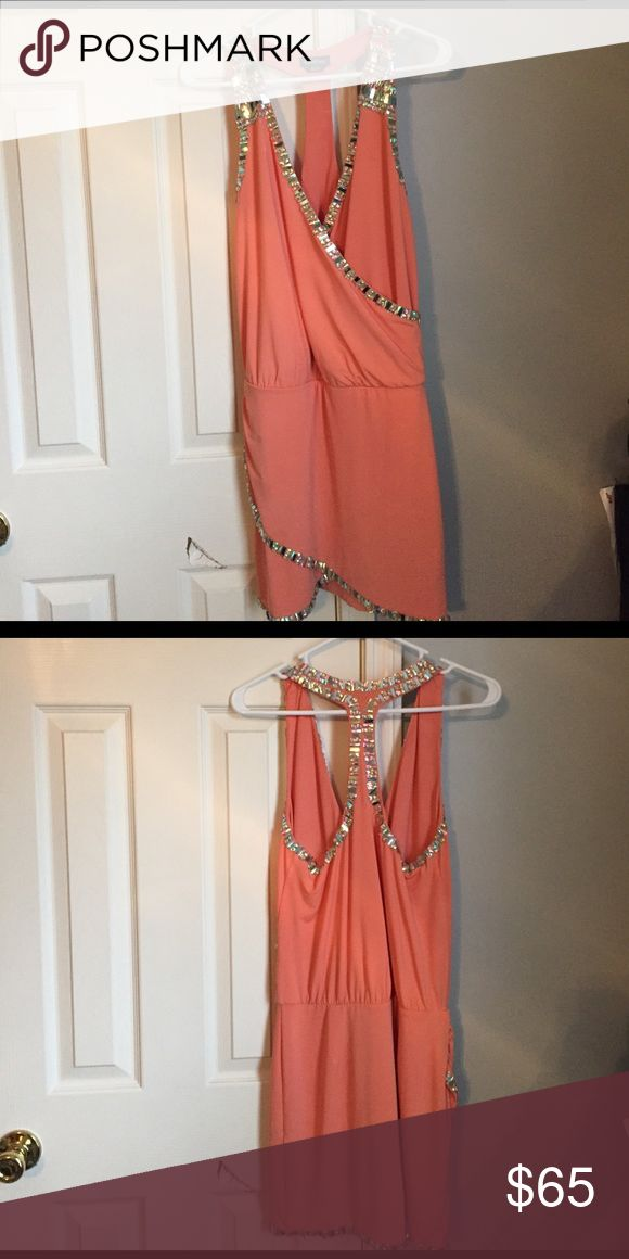 Going out dress Peach going out dress from Bebe! No tags but never worn!  Perfect condition:) bebe Dresses Mini