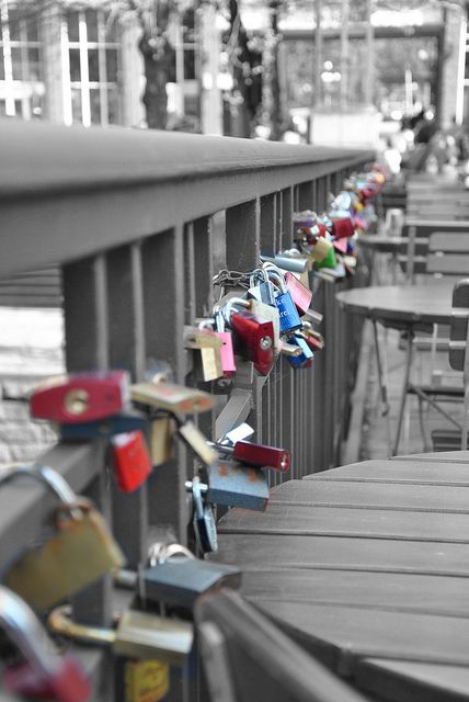 write the name of friend/boyfriend/girlfriend on the lock then lock it to the bridge and throw the key into the river