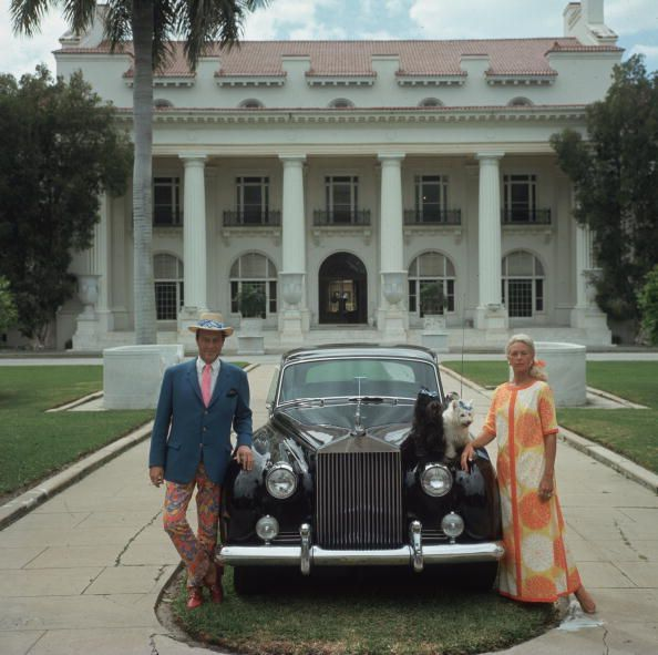 Mr. and Mrs. Donald Lease with their Rolls Royce and two pet dogs outside their home in Palm Beach, Florida, April, 1968...