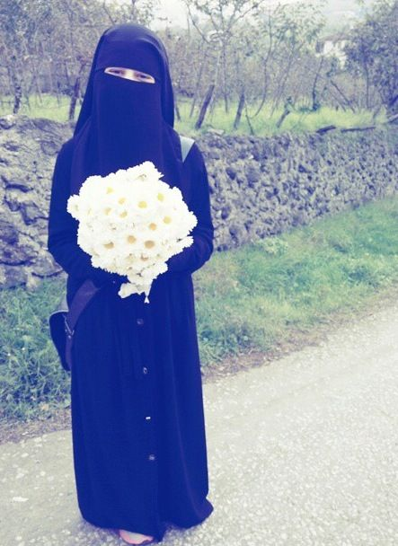 Muslimah with bouquet of flowers