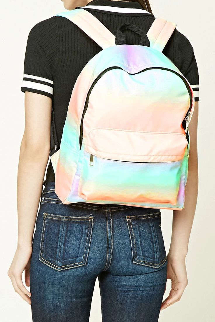 An unstructured backpack featuring a watercolor tie-dye design, a zipper compartment, a front zip pocket, an interior zip pocket, two interior slip pockets, top handle, and adjustable shoulder straps.
