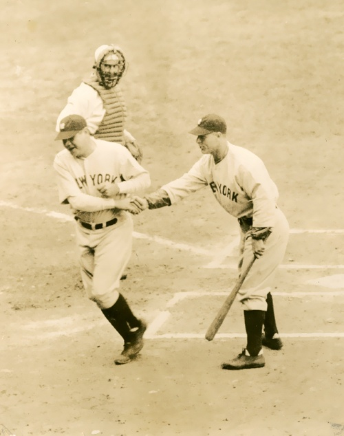 Babe is congratulated by Lou after another home run - 1932.