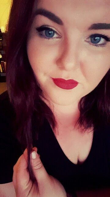 Me. Red lips, gold shadow and think brows