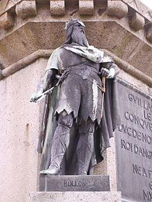 The fiefdom of Normandy was created in 911 for the Viking leader Rollo (also known as Rolf).  After participating in many Viking incursions along the Seine, culminating in the siege of Paris in 886, Rollo was finally defeated by King Charles the Simple. Rollo swore fealty to the French King, converted to Christianity and was baptized with the name Robert. Charles then granted Rollo territories around Rouen, which came to be called Normandy after the Northmen (Latinised Normanni).
