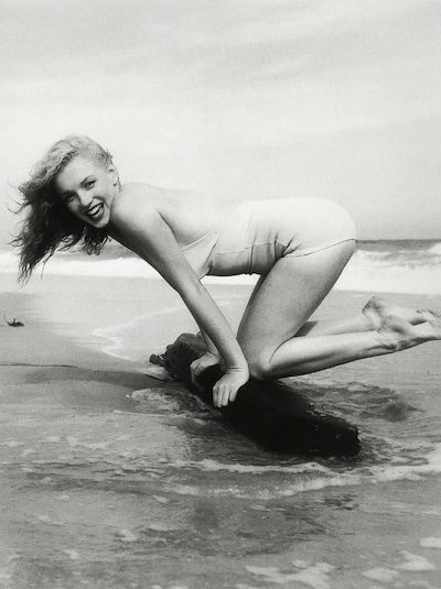 Site says it's Marilyn Monroe... kinda looks like her and kinda doesn't.  Still, a cute photo.