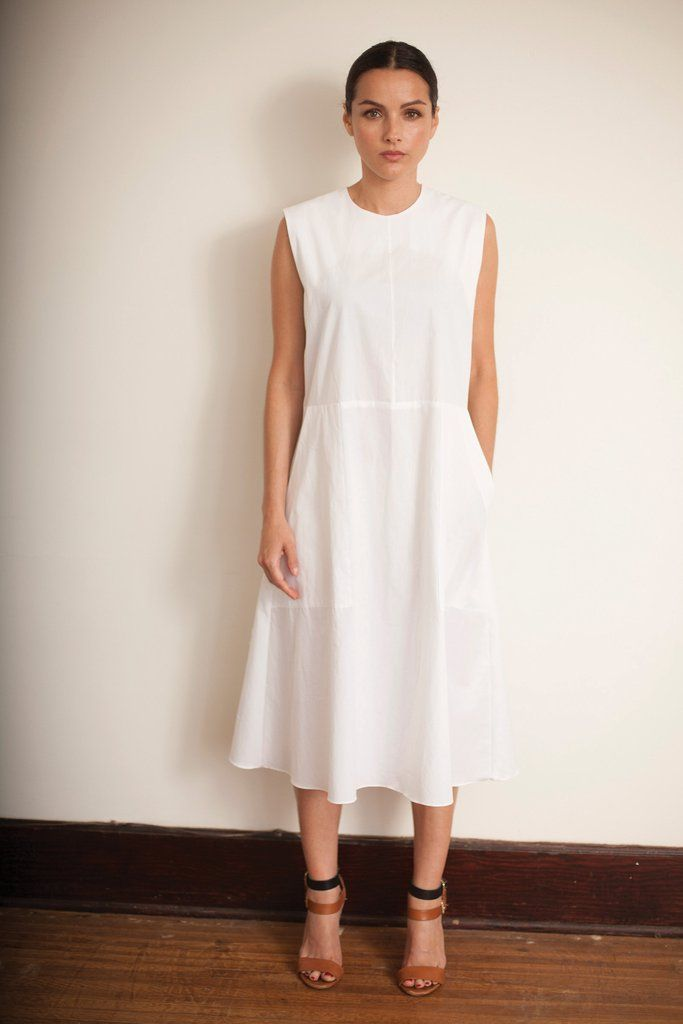"""Short Sleeve A-Line Dress with deep front pockets Hidden zipper in back  S - chest: 18"""" waist: 17 1/4"""" length: 42 1/2""""   Made in Los Angeles 100% Cotton Dry Clean Only"""