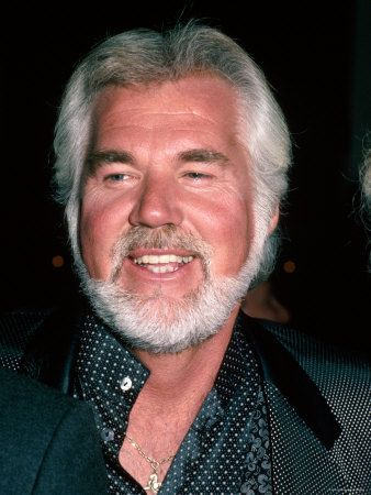 Kenny Rogers -  Had great love songs in the 70-80's  LADY.... And She believes in Me .....