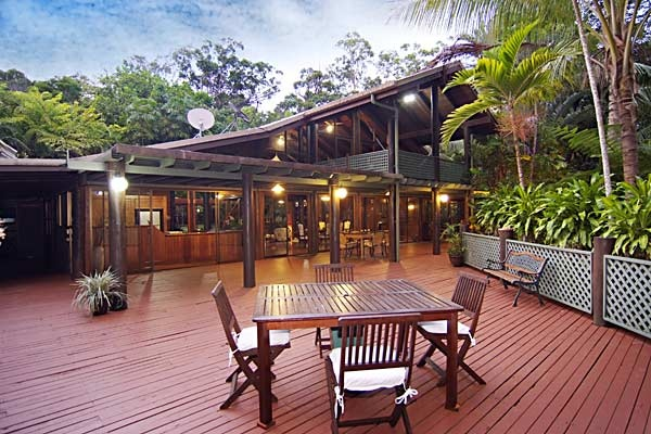 """Wait-a-While Retreat, The Daintree - """"You will see more rainforest life during one late-afternoon relaxing on the verandah at Wait-a-While Retreat with a cooling glass of Chardonnay in hand than in a month of harried bus tours. This astonishing solar-powered eco-retreat is one of the wonders of the Daintree and provides a true rainforest-by-the-beach experience."""""""