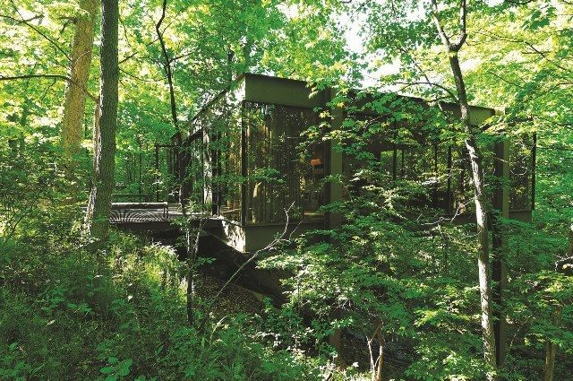 Built by Ludwig Mies van der Rohe protégé A. James Speyer in 1953, Cameron Frye's house from Ferris Bueller's Day Off is for sale and comes with a 4-car garage...and plenty of room to rev up your vintage Ferarri to the point that it peels off the ledge