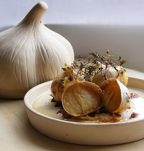 Instructions for a garlic roaster | eHow UK~ Also has instructions for roasting an onion in a terra cotta garlic roaster. 176 Celsius is roughly 350 farenheit