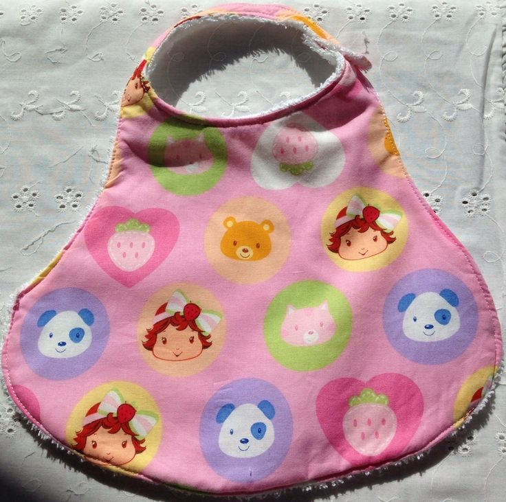 Beautiful handmade bibs. Made with sweet strawberry shortcake fabric with toweling backing