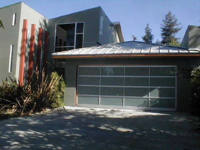 Metal roof and a glass garage door exteriors pinterest for Modern metal roof
