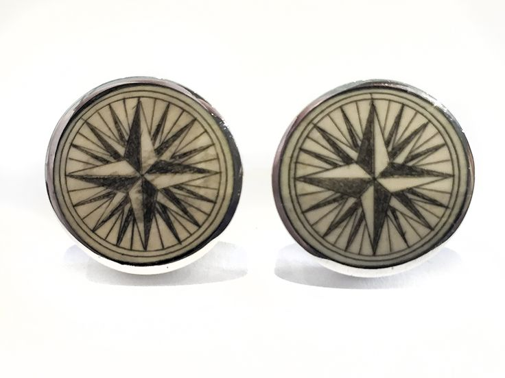 """Handmade sterling silver cufflinks by Jenkins with scrimshaw by David Smith on ancient mammoth ivory. We do not get many of these compass rose Smith cufflinks anymore, but whenever we do they are always first rate. Great work, as usual. Size: 3/4"""" Diameter  Price: $275.00 -- on ScrimshawGallery.com #cufflinks #jewelry #scrimshaw"""