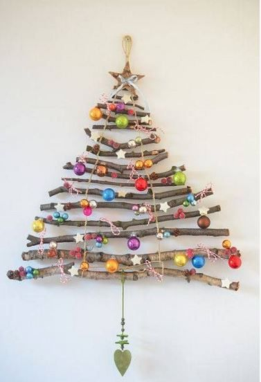 Super crafty ornament! And so colorful! Perfect on a wrought iron twig ornament stand!