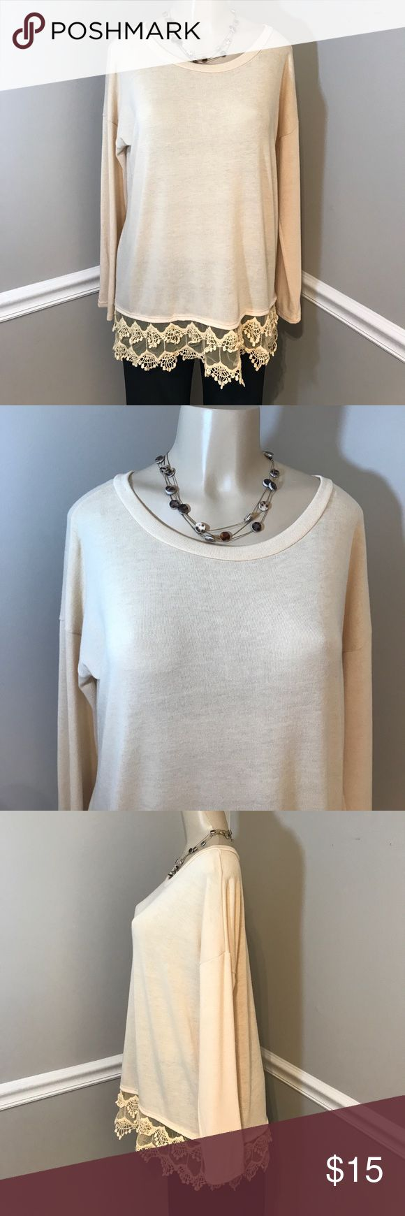 "Emerald Lacy Cream Long Sleeve Top Size Large NWT This shirt features lace detail around bottom hem. Bust measures 23"" laying flat. Length 28"" shoulder to bottom of hem. New with tags. Smoke free home. (AC) Emerald Tops Blouses"