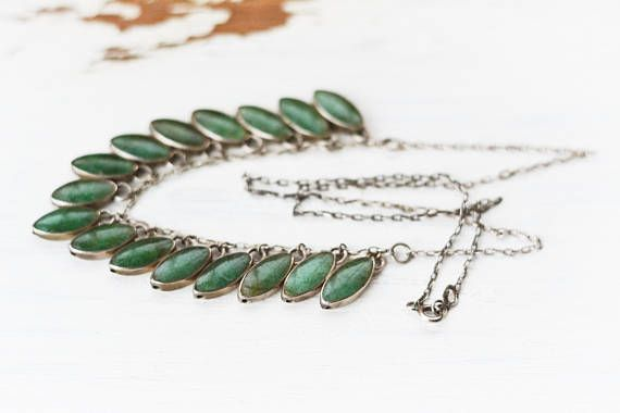 This is a vintage sterling silver and aventurine or jade boho necklace. Amazing casual chain and green almond shape gemstone design! Really cool and casual. great colour of medium green. Looks amazing worn with other chains and beads! This is vintage, so I only have this one! Once it is