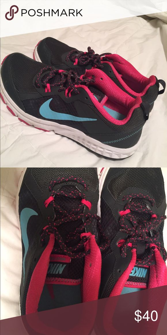 Nike Tennis Shoes, never worn Dark grey, pink and blue Nike tennis shoes. Perfect condition, never worn! Nike Shoes Athletic Shoes