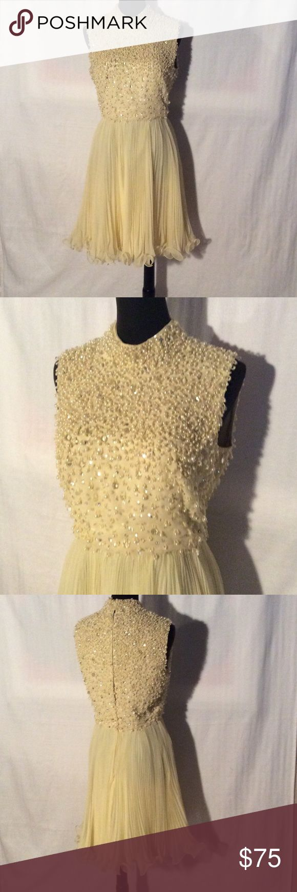 Chiffon Dress - Pleated Skirt and Embellished Top 1960's pale yellow chiffon dress with plissé pleated skirt and embellished top. Crystals, beads and pearls adorn the bodice. The measurements are approximately: bust 36 waist 29 hip 37. It is a size 6. I have no idea the original price. Dresses Midi