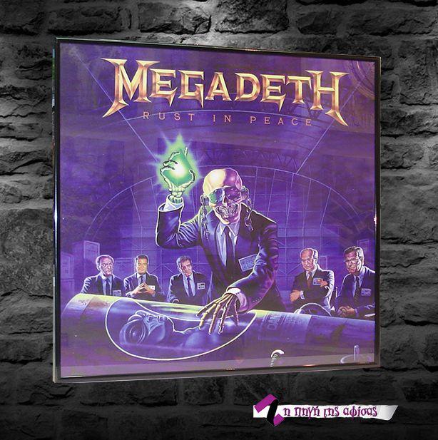 Megadeth, Rust in Peace Εκτύπωση αφίσας (εξώφυλο άλμπουμ) σε διαστάσεις 60x60εκ. και μοντάρισμα μεταλλικής μάυρης κορνίζας με απλό τζάμι. Μετωπικό προφίλ κορνίζας 1εκ. Πλαινό προφίλ κορνίζας 2εκ. Συνολική διάσταση θέματος και κορνίζας 60x60εκ.