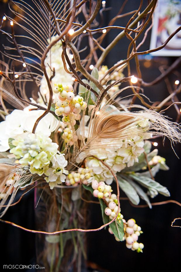 Floral arrangements with lights in them - neat idea for evening event or evening wedding - esp outdoor!