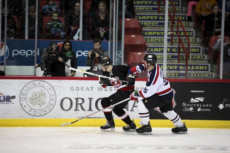 NHL's Troy Crowder hunts down Rocker Andrew Usenik.  CARAS/iPhoto
