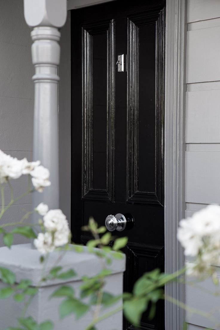 Black gloss front door. Heritage exterior.   Full home renovation in Richmond, Melbourne by the M.J.Harris Group including full interior and exterior painting by M.J.Harris Group. Photo credit J.Harri