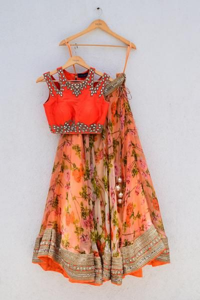 Style:Floral printed lehenga with orange cutwork blouse Fabric:Organza, net , Raw silk, hand embroidery Size:Medium Product is available in other colours. Pr