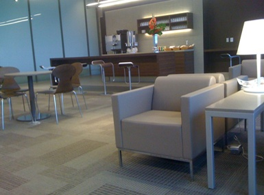 Porter Airlines Lounge - club chairs are comfy and side tables are compact