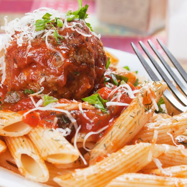 A Yummy large meatball recipe served with homemade sauce and penne pasta.. Italian Large Meatball on Pasta Recipe from Grandmothers Kitchen.