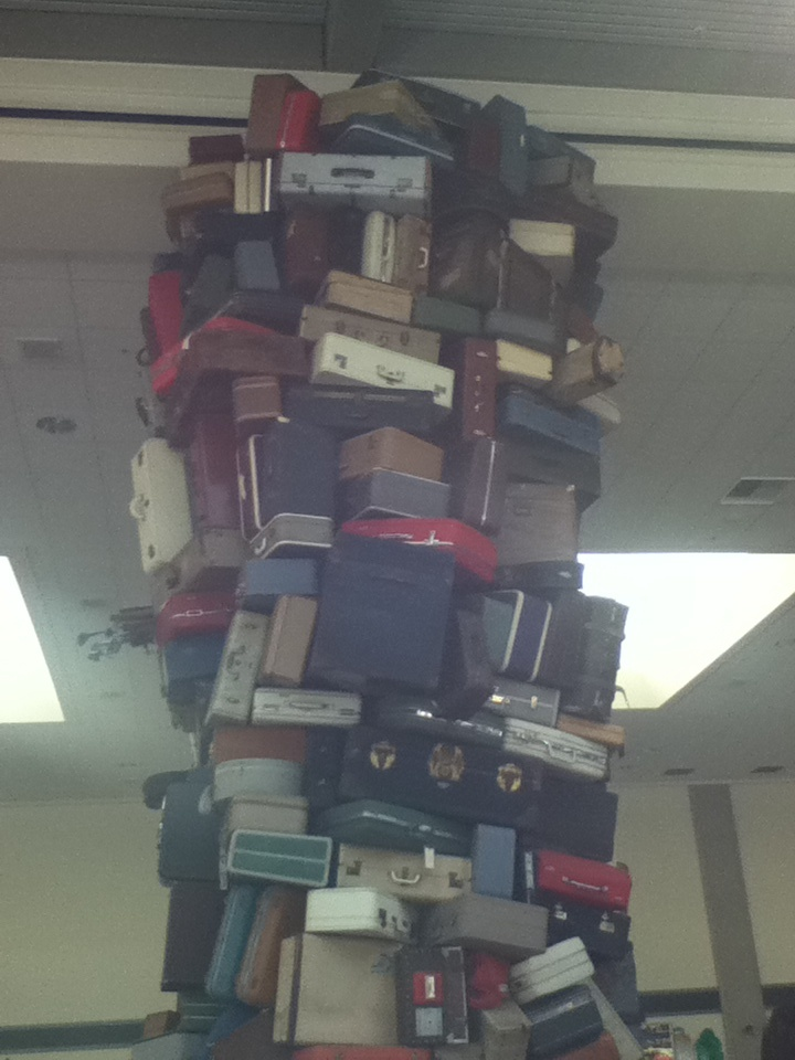 Suitcase sculpture in the baggage claim area of the Sacramento airport - wonder who lost all these.