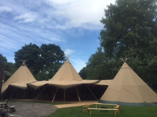 Our tipis all set up with benches to add to the feel, these are a great optional extra to match our outside fire pit.. #Tipi #winter #wedding #festival #party #marquees #events
