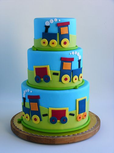 Train cake--- super cute and simple... Just simple shapes arranged to form a train.