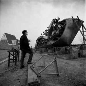 Tom Bass sculptor, Cow Pasture Hill, Minto at work on sculpture, 1968. Kerry Dundas photo.